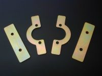 Spring retaining plate, front ' omega